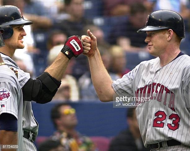 Minnesota Twins centerfielder Bobby Kielty gets the highfive from teammate Corey Koskie after hitting a tworun homer in the fourth inning of American...