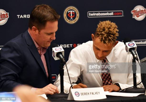 Minnesota Twins Chief Baseball Officer Derek Falvey looks on as Minnesota Twins No 1 overall draft pick Royce Lewis signs his contract during a press...