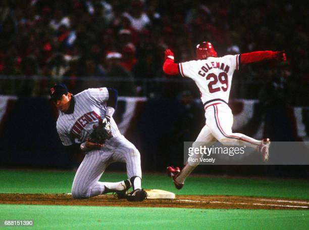 Minnesota Twins first baseman Kent Hrbek fields a low throw to first base as Vince Coleman of the St Louis Cardinals is called out on the play during...