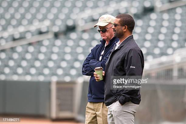 Minnesota Twins general manager Terry Ryan looks on with scouting director Deron Johnson during a predraft workout on June 3 2013 at Target Field in...