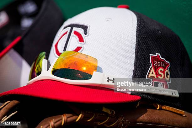 Minnesota Twins hat with the 2014 AllStar Game logo patch on the steps of the dugout during an intrasquad scrimmage in spring training on February 27...