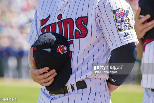 Minnesota Twins jersey and hat with the 2014 AllStar Game logo against the Toronto Blue Jays during a spring training game on March 3 2014 at Hammond...