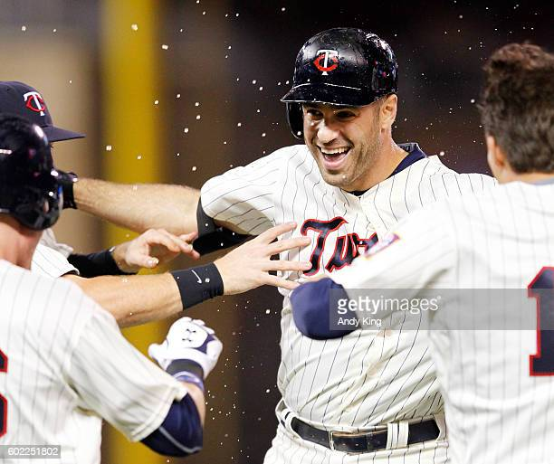 Minnesota Twins Joe Mauer celebrates with teammates after Mauer hit a walkoff single to beat Cleveland Indians 21 in a twelve inning game at Target...