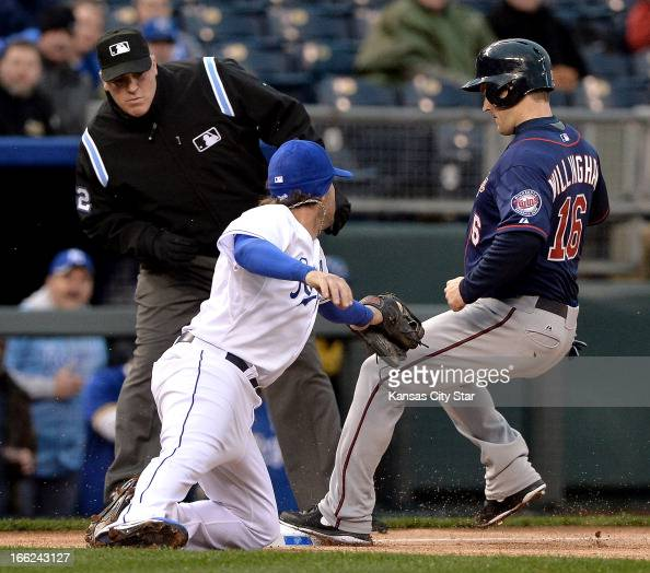 Minnesota Twins' Josh Willingham reaches third before the tag from Kansas City Royals third baseman Mike Moustakas on a broken bat single by Justin...