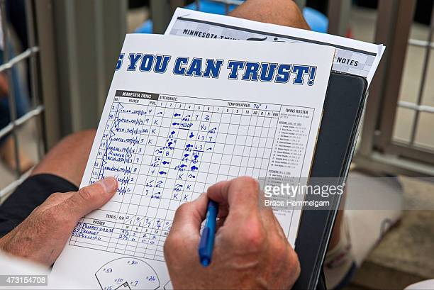 Minnesota Twins keeps the book with a pen on his scorecard against the Chicago White Sox on May 3 2015 at Target Field in Minneapolis Minnesota The...