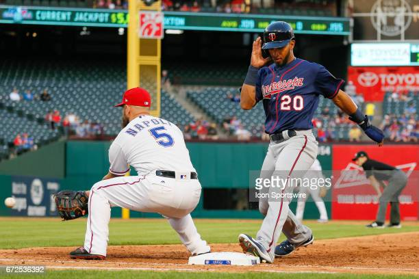 Minnesota Twins Left field Eddie Rosario shields his face as he returns to 1st base during the MLB game between the Minnesota Twins and Texas Rangers...