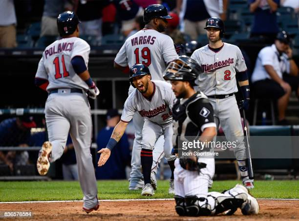 Minnesota Twins left fielder Eddie Rosario celebrates with Minnesota Twins shortstop Jorge Polanco after the home run during the game between the...