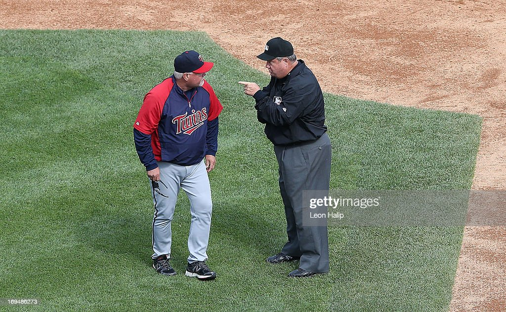 Minnesota Twins manager Ron Gardenhire argues an interference call on Josh Willingham with second base with Umpire Joe West during the third inning...