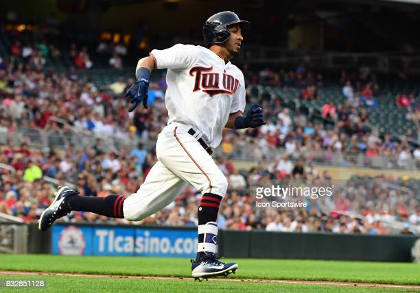 Minnesota Twins Outfield Eddie Rosario rounds 1st and heads to 2nd with a double during a MLB game between the Minnesota Twins and Cleveland Indians...