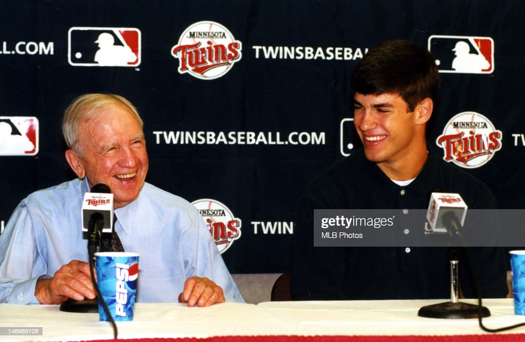 Minnesota Twins owner Carl Pohlad and first overall draft pick <a gi-track='captionPersonalityLinkClicked' href=/galleries/search?phrase=Joe+Mauer&family=editorial&specificpeople=214614 ng-click='$event.stopPropagation()'>Joe Mauer</a> are seen during a press conference at the Metrodome on June 6, 2001 in Minneapolis, Minnesota.