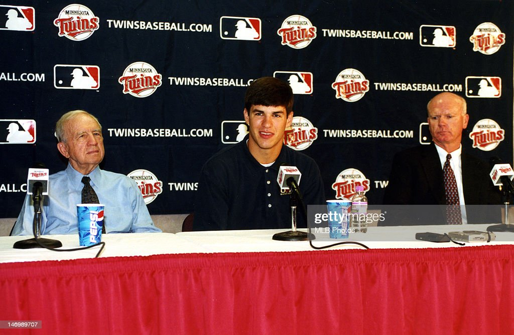 Minnesota Twins owner Carl Pohlad, first overall draft pick <a gi-track='captionPersonalityLinkClicked' href=/galleries/search?phrase=Joe+Mauer&family=editorial&specificpeople=214614 ng-click='$event.stopPropagation()'>Joe Mauer</a> and Minnesota Twins general manager Terry Ryan are seen during a press conference at the Metrodome on June 6, 2001 in Minneapolis, Minnesota.