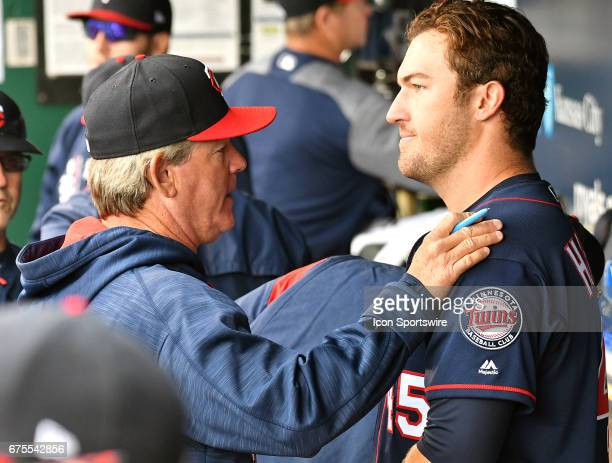 Minnesota Twins pitching coach Neil Allen talks to Minnesota Twins starting pitcher Phil Hughes after he was relieved in the sixth inning during a...