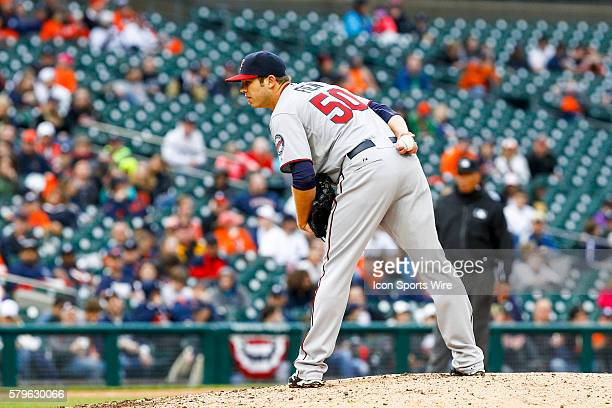 Minnesota Twins relief pitcher Casey Fien looks for the pitch sign during a regular season game between the Minnesota Twins and the Detroit Tigers...
