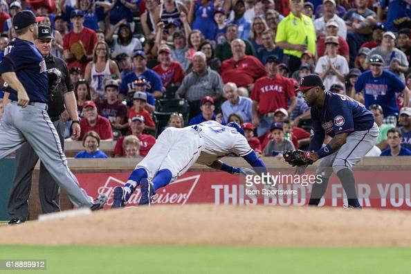 Minnesota Twins right fielder Miguel Sano waits to tag out Texas Rangers center fielder Ian Desmond during a rundown during the game between the...