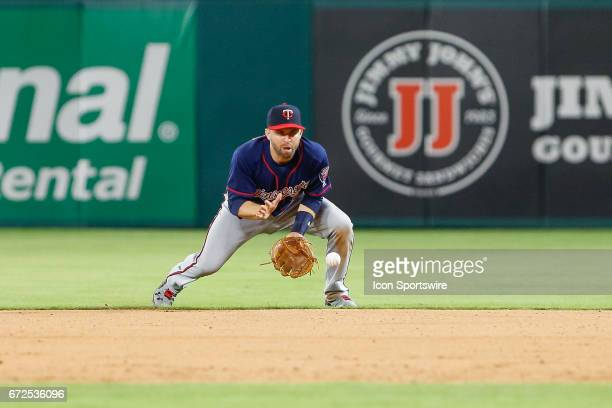 Minnesota Twins Second base Brian Dozier plays a ground ball during the MLB game between the Minnesota Twins and Texas Rangers on April 24 2017 at...