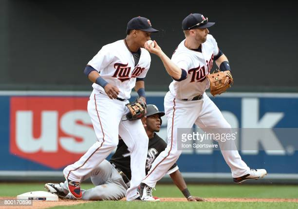 Minnesota Twins Second base Brian Dozier throws to 1st as Minnesota Twins Shortstop Jorge Polanco and Chicago White Sox Shortstop Tim Anderson look...