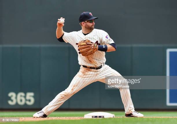 Minnesota Twins Second base Brian Dozier throws to 1st to complete a double play during a MLB game between the Minnesota Twins and New York Yankees...