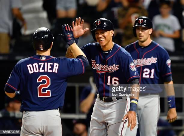 Minnesota Twins second baseman Brian Dozier and Minnesota Twins shortstop Ehire Adrianza celebrate after Minnesota Twins second baseman Brian Dozier...
