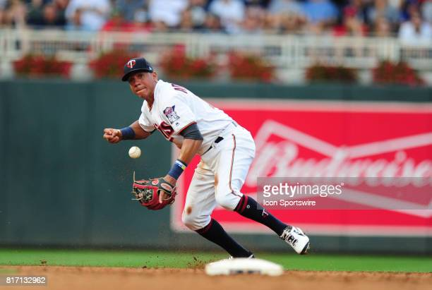 Minnesota Twins shortstop Ehire Adrianza bobbles a ground ball hit by New York Yankees Designated hitter Matt Holliday in the first inning of their...