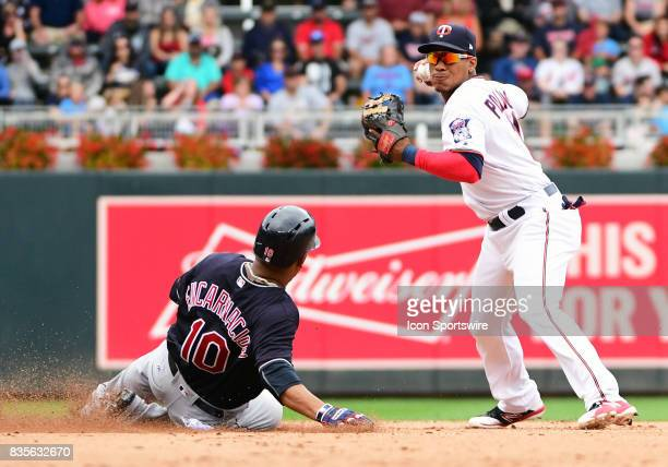 Minnesota Twins Shortstop Jorge Polanco throws over a sliding Cleveland Indians Designated hitter Edwin Encarnacion to complete a double play during...