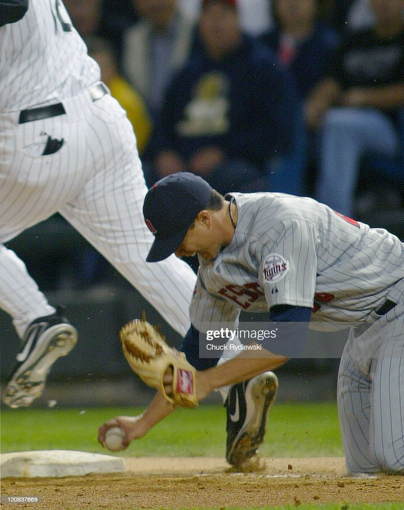 Minnesota Twins' Starter, Kyle Lohse, makes a diving tag of A.J. Pierzynski during the game against the Chicago White Sox September 23, 2005 at U.S. Cellular Field in Chicago, Illinois. The White Sox led the Twins 3-0 in the 6th inning.