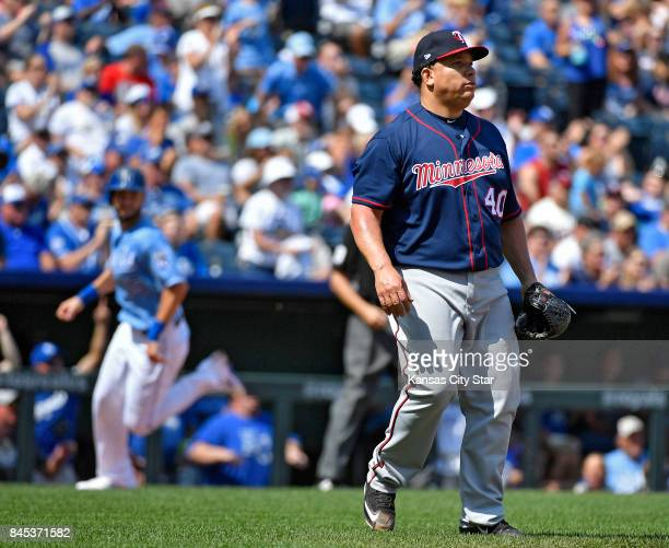 Minnesota Twins starting pitcher Bartolo Colon watches an RBI double by Kansas City Royals designated hitter Brandon Moss as Eric Hosmer scores in...
