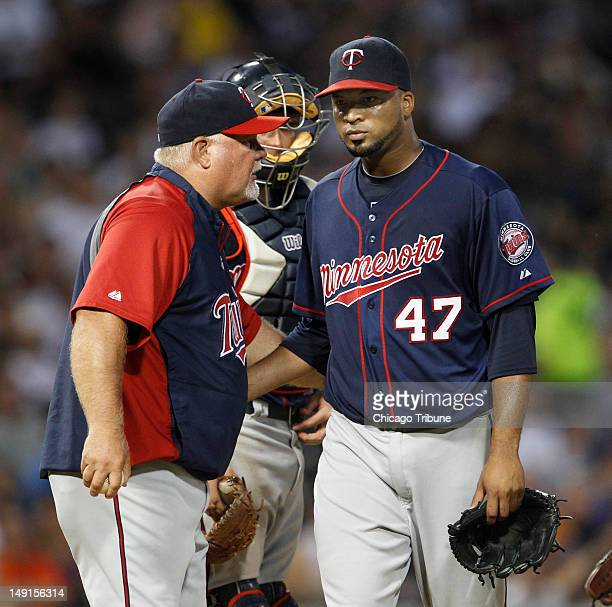 Minnesota Twins starting pitcher Francisco Liriano gets pulled by Minnesota Twins manager Ron Gardenhire during the third inning of their game...