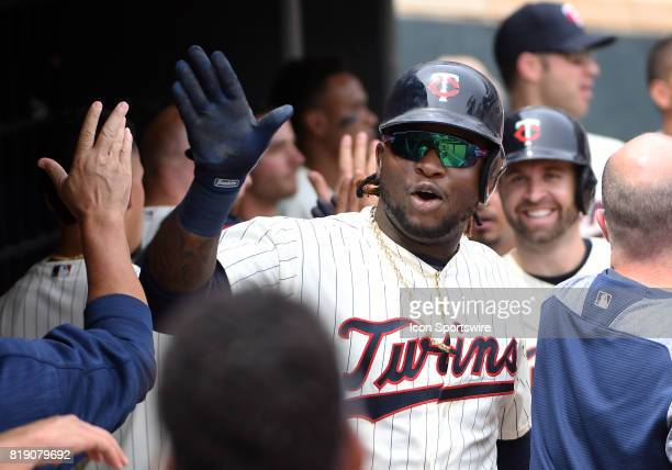 Minnesota Twins Third base Miguel Sano highfives teammates after hitting a 3run home run in the bottom of the 2nd during a MLB game between the...