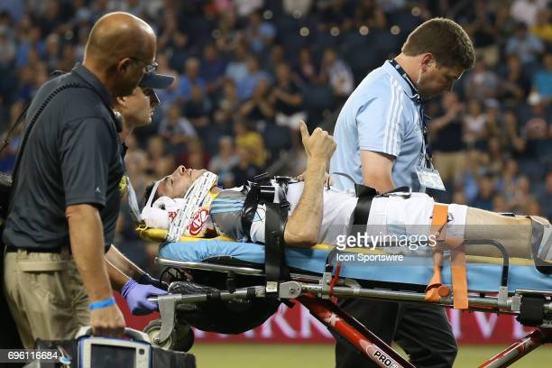 Minnesota United defender Joseph Greenspan gives the thumbs up sign while being removed from the field on a stretcher in the second half of a US Open...