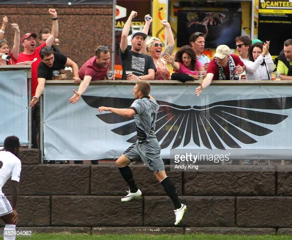 Minnesota United FC defenseman celebrates with fans after scoring a goal on Swansea City in the first half of their friendly soccer match on July 19...