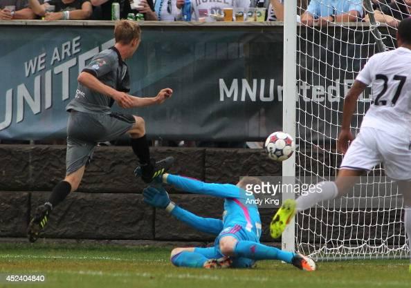 Minnesota United FC defenseman Greg Jordan scores on a goal Swansea City goalie Gerhard Tremmel in the first half of their friendly soccer match on...