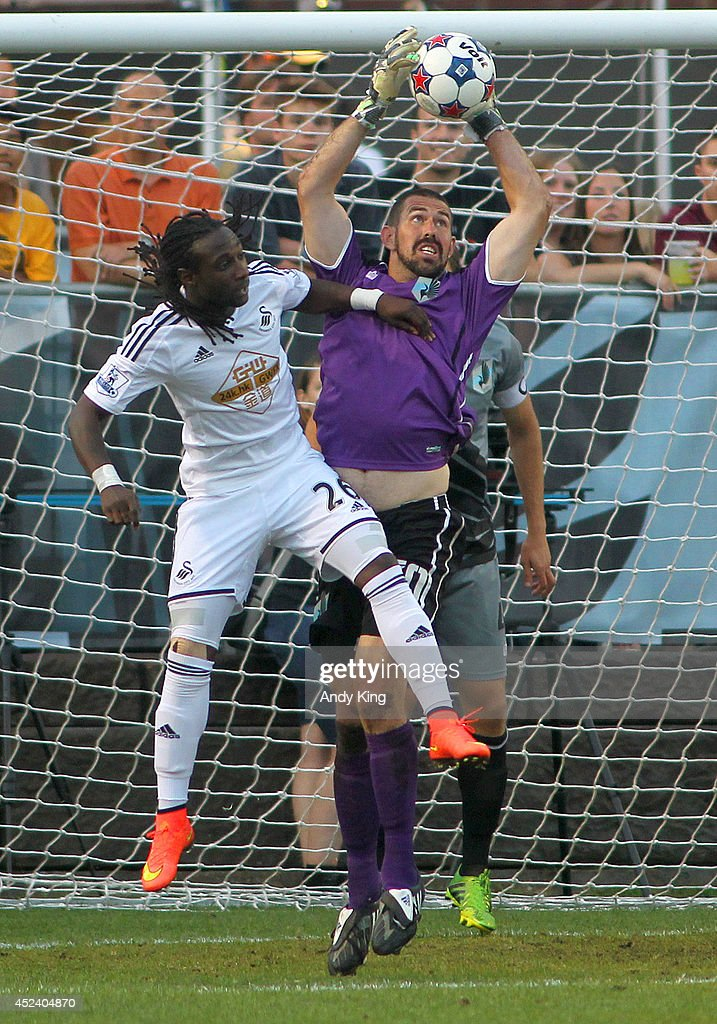 Minnesota United FC goalie Matt VanOekel (30) makes a save on an attempt by Swansea City forward Marvin Emnes in the second half of their friendly soccer match on July 19, 2014 at the National Sports Center in Blaine, Minnesota. Minnesota United FC defeated Swansea City 2-0.
