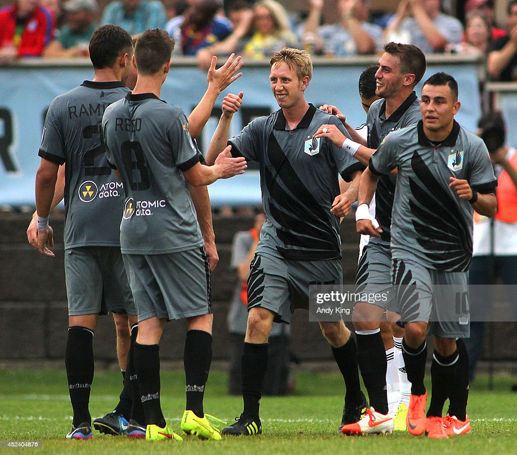 Minnesota United FC player congratulate defenseman <a gi-track='captionPersonalityLinkClicked' href=/galleries/search?phrase=Greg+Jordan&family=editorial&specificpeople=3011598 ng-click='$event.stopPropagation()'>Greg Jordan</a> (center) after he scored on Swansea City in the first half of their friendly soccer match on July 19, 2014 at the National Sports Center in Blaine, Minnesota.