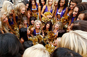 Minnesota Vikings cheerleaders get ready prior to the NFL Hall of Fame Game against the Pittsburgh Steelers at Tom Benson Hall of Fame Stadium on...