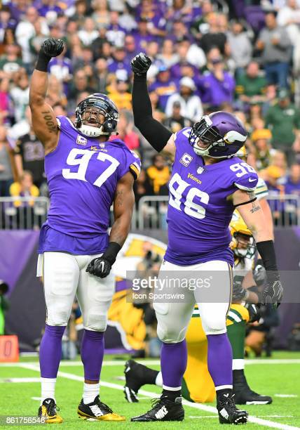 Minnesota Vikings defensive end Everson Griffen and Minnesota Vikings defensive end Brian Robison hold up their imaginary fish during a postsack...