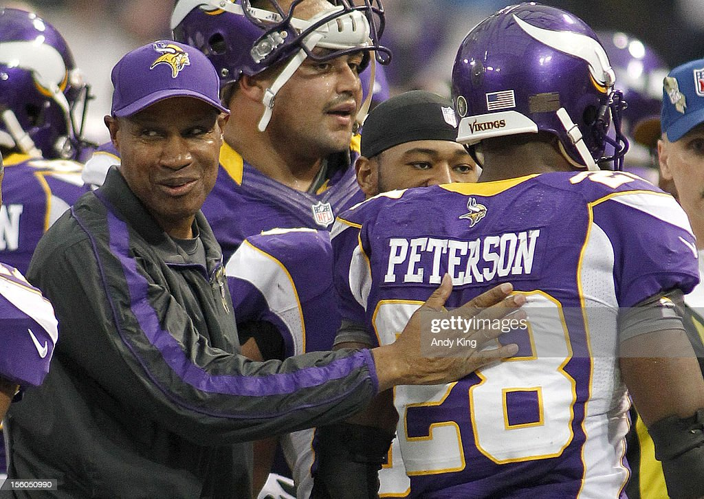 Minnesota Vikings head coach Leslie Frazier congratulates Adrian Peterson #28 of the Minnesota Vikings after a 61-yard touchdown against the Detroit Lions in the fourth quarter November 11, 2012 at Mall of America Field at the Hubert H. Humphrey Metrodome in Minneapolis, Minnesota. The Vikings defeated the Lions 34-24.