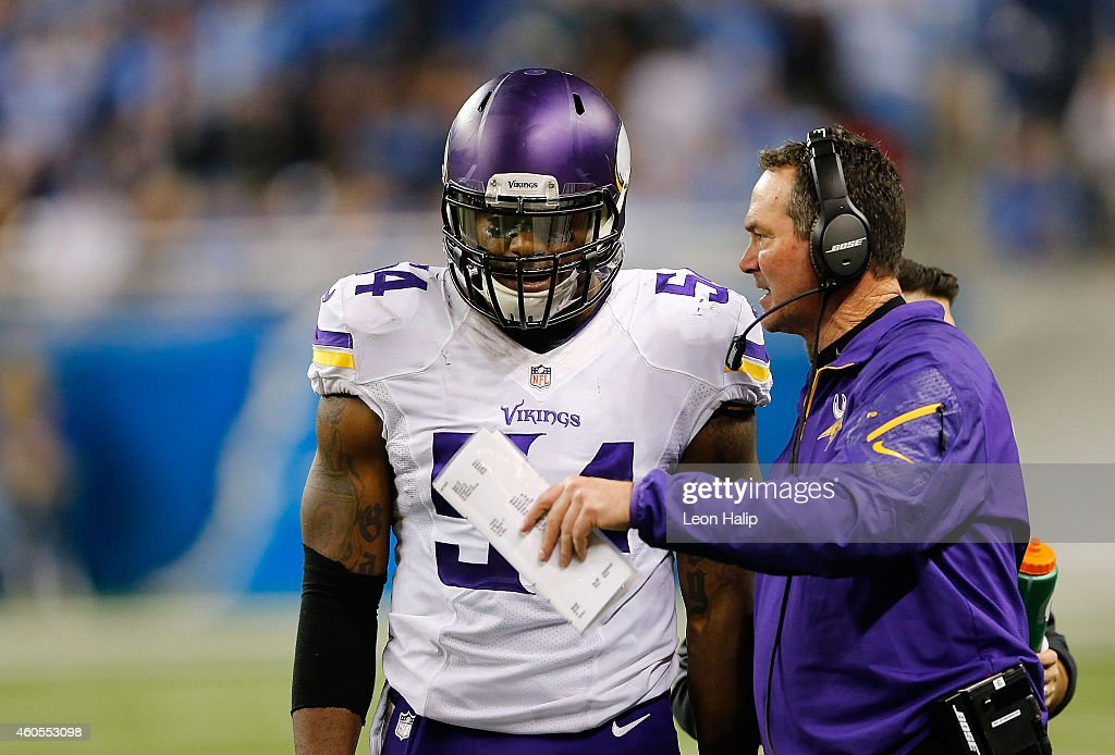 Minnesota Vikings head football coach Mike Zimmer talks with <a gi-track='captionPersonalityLinkClicked' href=/galleries/search?phrase=Jasper+Brinkley&family=editorial&specificpeople=4032417 ng-click='$event.stopPropagation()'>Jasper Brinkley</a> #54 during the second quarter of the game against the Detroit Lions at Ford Field on December 14, 2014 in Detroit, Michigan. The Lions defeated the Vikings 16-14.
