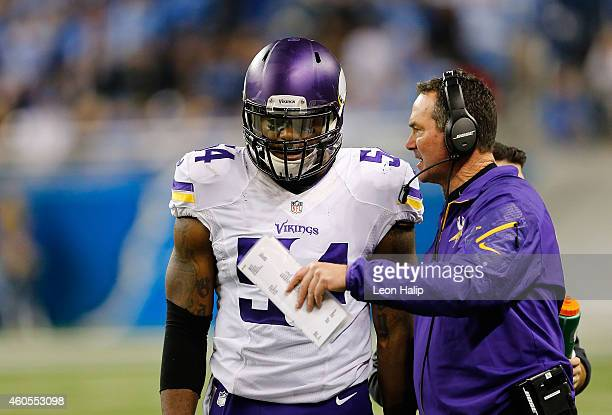 Minnesota Vikings head football coach Mike Zimmer talks with Jasper Brinkley during the second quarter of the game against the Detroit Lions at Ford...