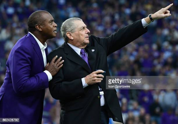 Minnesota Vikings owner and vice chairman Leonard Wilf shows Minnesota Vikings great Ahmad Rashad his place in the Vikings Ring of Honor during a NFL...