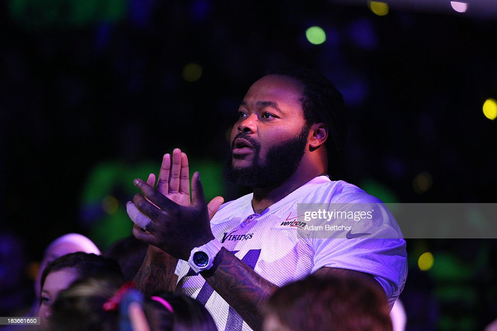 Minnesota Vikings Phil Loadholt claps during the We Day Minnesota event at the Xcel Energy Center in St. Paul, Minnesota on October 8, 2013
