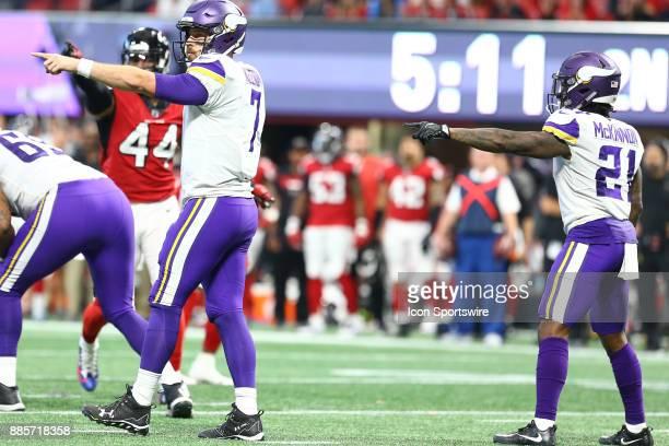 Minnesota Vikings quarterback Case Keenum and Minnesota Vikings running back Jerick McKinnon point out a change in the Atlanta Falcons defense during...