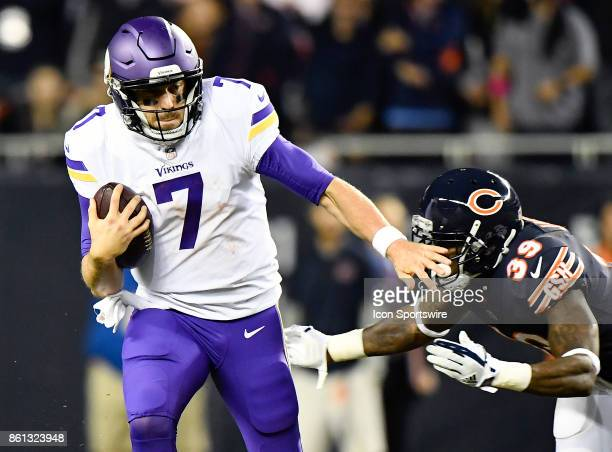 Minnesota Vikings quarterback Case Keenum runs for a first down before being tackled by Chicago Bears free safety Eddie Jackson during the game...
