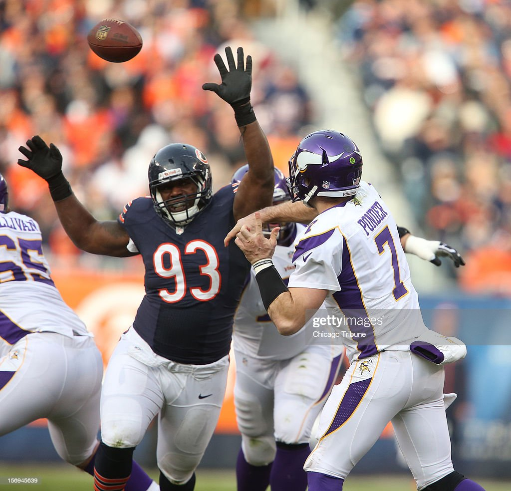 Minnesota Vikings quarterback Christian Ponder (7) throws a pas while under pressure from Chicago Bears defensive tackle Nate Collins (93) during the second half at Solider Field on Sunday, November 25, 2012, in Chicago, Illinois. The Bears defeated the Vikings, 28-10.