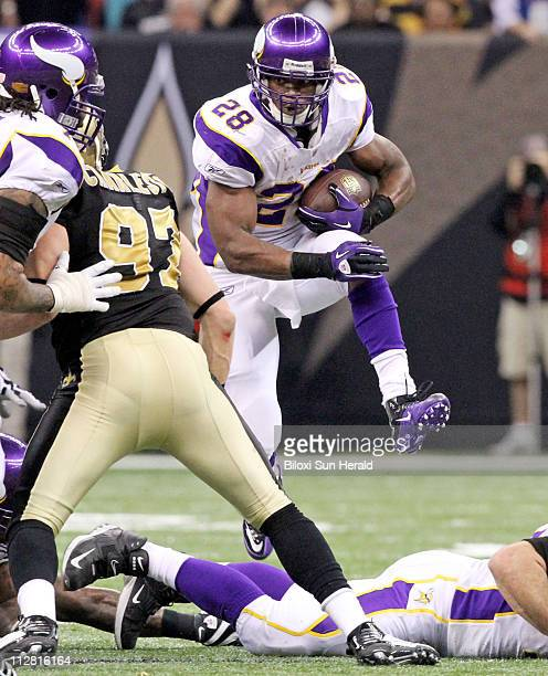 Minnesota Vikings running back Adrian Peterson carries the ball against New Orleans Saints during the second quarter of the NFC Championship at the...
