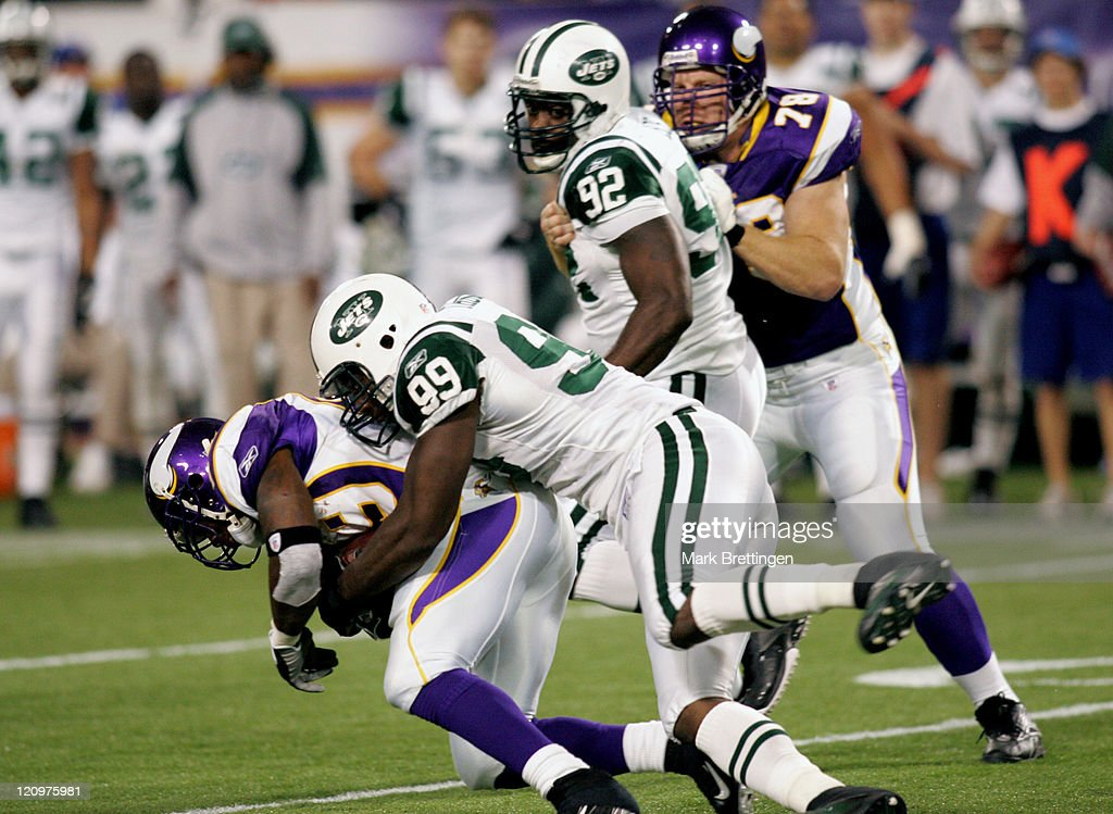 Minnesota Vikings running back Chester Taylor is tackled by New York Jet Bryan Thomas at the Metrodome Minneapolis Minnesota December 17 2006 The...