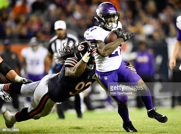 Minnesota Vikings running back Jerick McKinnon is tackled by Chicago Bears outside linebacker Pernell McPhee during the game between the Minnesota...