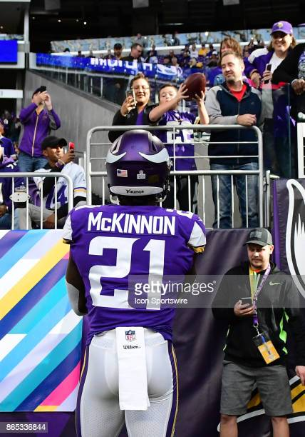 Minnesota Vikings running back Jerick McKinnon throws a ball to a young fan during a NFL game between the Minnesota Vikings and Baltimore Ravens on...