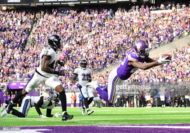 Minnesota Vikings running back Latavius Murray dives across the goal line for a touchdown at the end of a 29yard run during a NFL game between the...