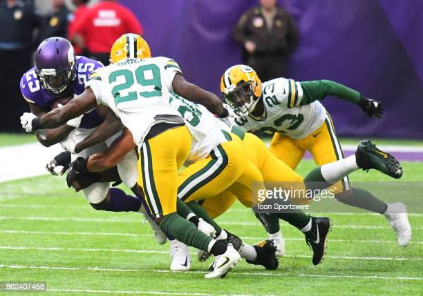 Minnesota Vikings running back Latavius Murray is brought down by a group of Packer defenders during a NFL game between the Minnesota Vikings and...