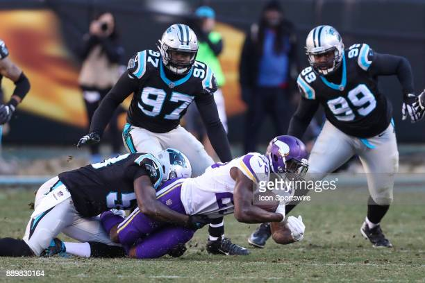 Minnesota Vikings running back Latavius Murray is brought down by Carolina Panthers middle linebacker Luke Kuechly during the second half on December...